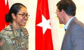 SPC Naomi Sautia-Pomele, of the 548th Combat Sustainment Support Battalion, was recognized at a Fort Drum town hall meeting with Secretary of the Army Dr. Mark T. Esper during his visit on March 29, 2018.  Sautia-Pomele was one of five female soldiers to be nationally recognized during Women's History Month for exceptional service to the US Army.  [photo credit: SGT Liane Hatch]