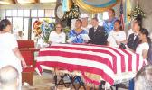 The United States flag draped casket of the late former Sen. Fuata Dr. Tagiilima I'atala, during his memorial service on Sunday at the CCCAS church in Amouli, with his children and his wife, Manumanu Sipili I'atala  (in white and wearing a hat — far left). [photo: Samoa News]