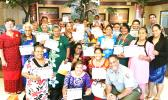 "Twenty senior citizens from the Territorial Administration on Aging (TAOA), along with director Evelyn Lili'o-Satele (far left), became the first class of TAOA seniors to be appointed 'Senior Rangers' of the National Park Service. The group's members have pledged to ""explore, learn about, and help protect the National Park of American Samoa and all National Parks"".  [photo: courtesy]"
