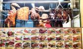 A cook arranges his roast pork, duck and chicken offerings at the Food Loft, Woodlands, Singapore. [photo: Barry Markowitz, 5/1/18]