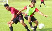A Tafuna Warriors' player and Faga'itua Vikings' opponent, in action during an ASHSAA Boys' varsity soccer game Friday, April 6, 2018 at Pago Park Soccer Stadium.  [FFAS MEDIA/Brian Vitolio]