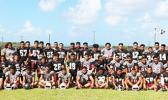Tafuna High School's varsity and JV football squads, posing for Samoa News before a friendly scrimmage against the Wildcats late this summer, in preparation for the upcoming ASHSAA football season.  See more photos in slideshow. [photo: TG]