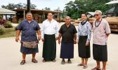 This undated photo provided by ASG Commerce Department, shows DOC director Keniseli Lafaele (far right), next to him is Paul Young, ASPA's Managing Director and the Governor's Tongan Liaison Officer, Sione Lousiale Lotolua Kava (far left) and officials of the Tonga Forestry and Milling Company in Tonga. In the background (on the right side) are electricity poles manufactured by the Tonga Forestry and Milling Company.  [photo: provided by DOC]