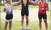 Winners of the Olympic Triathlon Course (1 mile swim, 24.6 mile bike, 6.2 mile run) that took place last Saturday at Utulei Beach: third place Matt Bracken, second place Patrick McEntire and first place Richard Birgander.  [photo: Ese Malala]