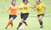 Two Pago Youth defenders (right) in action against an Utulei Youth during a women's game on Match Day 5 of the 2016 FFAS National League on Saturday, Sept. 17, at Pago Park Soccer Stadium.