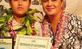 The winner of the 2018 Samoa News Spelling Bee with major sponsor representative — McDonald's American Samoa — Michael Sun of SPA- 1st place, and Carol Tautolo-Samuelu, GM of operations for McDonald's American Samoa. [photo: Leua Aiono Frost]