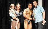 New Champion Aunese Tauinailoa of Aua and his sponsor Aaron Forsgren & family after winning the Sau Ia Bodybuilding Competition of 2017 held last Friday at the Gov. H. Rex Lee Auditorium in Utulei. [Photo: EM]