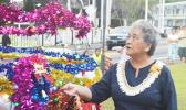First Lady Cynthia Malala Moliga turns on the switch to light the official Christmas Tree of the Territory — at the Fagatogo Pavilion on Sunday, during the first night of the 39th annual Holiday Music Festival hosted by the American Samoa Council on Arts, Culture & Humanities and the Department of Youth and Women's Affairs. Tonight is the last night of the holiday event. The public is invited to attend. [photo: AF]