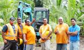 Happy Trucking workers pose for Samoa News photo