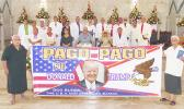 """Sen. Tuaolo Manaia Fruean (left) holding the """"Pago Pago for Trump"""" banner with Pulu Ae Ae Jr, while Paramount Chief Mauga T. Asuega, his wife and village traditional and church leaders (on stage)"""