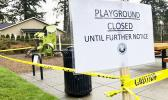 Police caution tape surrounds a playground in Lake Oswego, Ore.