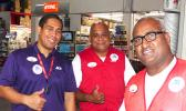 3 Neil's Ace Home Center employees giving customers a 'thumbs up'