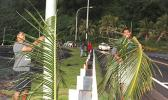 employees from the Department of Administrative Services, Housing Division, were seen at Faganeanea in 2019, decorating the roadside,