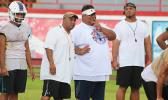All-Star Head Football Coach, Kevin Magalei speaking with his offensive coordinator, Sua'ese Pooch Ta'ase