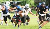 (FHS) Blessman Ta'ala immediately apprehends ball carrier, (THS) Andrew Toilolo, behind the line of scrimmage during an All-Star practice session.  [photo: TG]