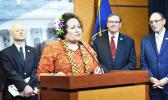 Aumua Amata speaking from podium