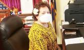 Amata with mask in D.C. office