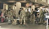 Some of American Samoa's 100th Infantry Battalion 442nd Regiment picking up their luggage at the Hilo airport