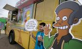 In this March 15, 2015, file photo, an Apu cutout is displayed at a Simpsons Kwik-E-Mart Truck