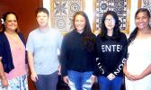ASCC President Dr. Rosevonne Makaiwi Pato congratulates this semester's recipients of the College's in-house scholarships. (l-r) Dr. Pato, Jin Lin Du, Louaivasa Laulu, Jingling Jiang, and Rianna Lafaele.  [Photo: J. Kneubuhl]