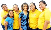 ASCC Business Department chairperson Dr. Faofua Faatoafe (center) celebrates with four of her students (and one of their daughters) upon their return from a field trip to the Independent State of Samoa, where they observed the operating methods of a number of businesses.