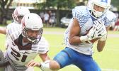 The Most Valuable Player of the Game, Elliot Lelei storming towards the end zone to score the first touchdown for Samoana High School — late in the second quarter — which tied up the ball game at six a piece, during the ASHSAA Football Championship game, last Saturday. Lelei also kicked the field goal to give the Blue Empire the 7- 6 lead, which they held throughout the match for their 1st ASHSAA Varsity football championship in 8 years. The Sharks also won the JV division this year.  [photo: TG]