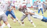 Tafuna's kick off returner was immediately apprehended in the backfield by a Samoana Shark, during the opening quarter of a Junior Varsity match up last Saturday morning.  [photo: TG]