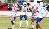 Jr. Tanielu releasing a screen pass just seconds before getting sandwiched by two Tafuna defenders, during their JV match up last Saturday morning. Tanielu led the Sharks in a 8-6 victory over the Warriors.  [photo: TG]