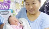 Mrs. Mrs Zhang Chao Jun and her New Year baby