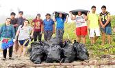 Young people with bags of rubbish picked up