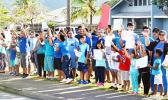 Faculty and staff of South Pacific Academy wore blue and along with all of their students joined the global awareness to stomp out bullying on Monday morning.  [Photo: JL]
