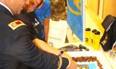 US Army Capt. Kurk Cruz Diaz, the Guam Recruitment Company Commander, with Bluesky official Sherry Sele, cutting the cake yesterday as part of the signing ceremony for the Army Partnership for Youth Success (PaYS) program with Bluesky Communications.  [photo: FS]