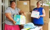 Malia Lameta and Joyce Purcell with boxes of donations
