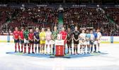 """The 2017 HSBC Canada Sevens Captain's photo took place last night with distinctly 'Canadian' flavour as the 16 teams were invited onto the ice prior to a Vancouver Canucks hockey game. Once the photo was taken, the Canadian and South African captains took part in a ceremonial faceoff with the captains of the New York Islanders and Vancouver Canucks.  The rugby players remained on the ice for the singing of the US and Canadian National anthems. [photo: courtesy World Rugby]"