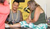 Christopher Adolfo Krieg smiles for the Samoa News Camera while tattooing a tourist