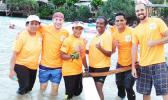 The LBJ Hospital put a team together to race at the first Harbor Classic V6 race last Friday at Sadie's by the Sea beach. Dentists and medical students compose the team, with many paddling for the very first time.  [Photo: Ese Malala]