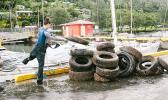 Stacking up tires cleaned up from the bottom of Malaloa Marina