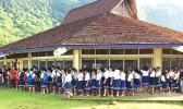 This photo taken yesterday and provided by the local Department of Education shows students at Peter Coleman Elementary School in Pago Pago lining up outside of a school building before the start of school yesterday. All public schools re-opened yesterday.  [photo: ASDOE]