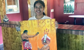 Katie Jewel Godinet with her artwork