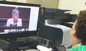 Aumua Amata speaking remotely with  Task Force Chairwoman Julia Brownley