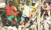 CJ Construction crew building a rock wall