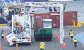Two vehicles going through the large container scanner at the main port yesterday morning as part of the training for Customs agents, who will be manning the scanner once the service is implemented by Customs.  [photo: FS]