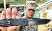 American Samoa son, Onosai Vine, Jr., equipped with a Ken Onion designed CRKT Homefront Tactical.  [Photo: Barry Markowitz]