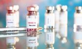 COVID vaccine viles and needle