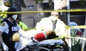 Firefighter continuing CPR on police shooting victim