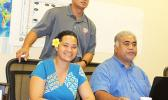 National Weather Service Office meteorologist Elinor Lutu-McMoore with local Department of Homeland Security officials Fale Ulufale and Vinnie Atofau.  [photo: FS]