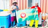 Two men in Alaska holding the Manu'a flag