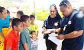 DOH crew distributing filariasis pills on Aunu'u