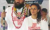 Denver Bronco's Domata Peko (left) and his wife Ann