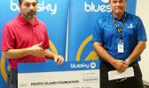 Ethan Lake (left) accepting a $20,600 contribution from Bluesky Pacific Group chief executive officer Toleafoa Tiafau Douglas Creevey